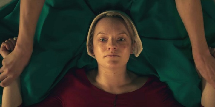 elizabeth-moss-in-the-handmaids-tale-sex-ceremony
