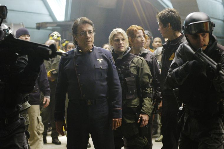 "BATTLESTAR GALACTICA -- SCI FI Channel -- ""Lay Down Your Burdens, Part 2"" Episode 20 -- Air Date 03/10/2006 -- Pictured: (l-r) Edward James Olmos as Admiral William Adama, Katee Sackhoff as Lieutenant Kara 'Starbuck' Thrace, Alisen Down as Jean Barolay, Michael Trucco as Samuel Anders -- Photo by: Carole Segal/SCI FI Channel/NBCUPB"